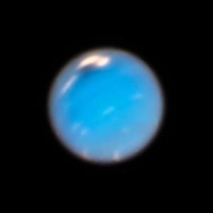 Dark storm on Neptune seen by Hubble.