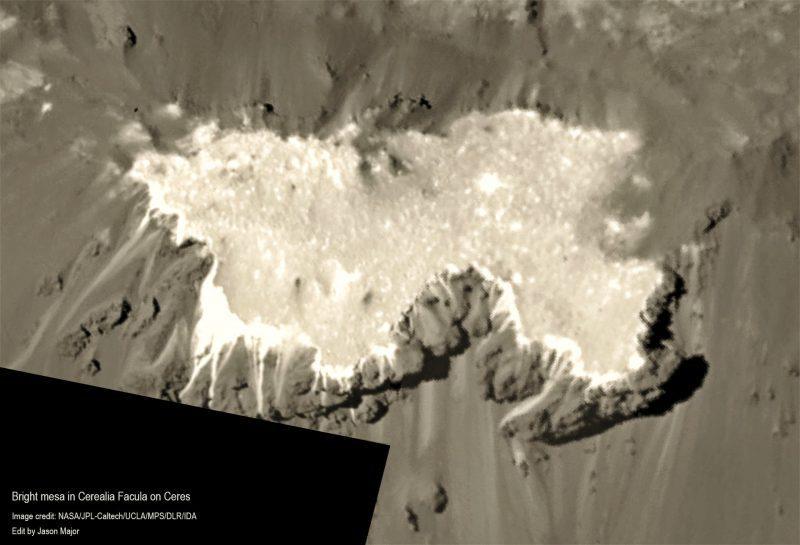 White ice-like surface of an irregular raised rocky area.
