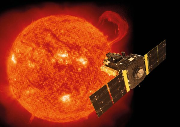 Orange sun with bright spots on it and a flare, and a spacecraft with solar panel 'wings'.