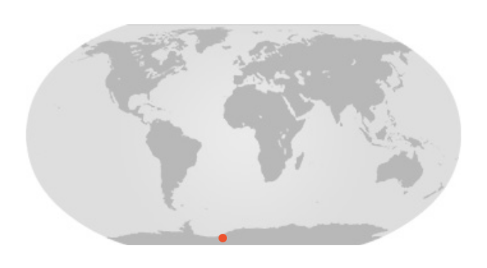 Map of whole world with red dot on the edge of Antarctica.