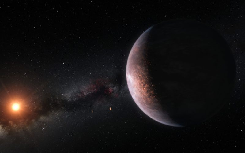 Rocky-looking planet seen from orbit with distant sun and Milky Way in background.