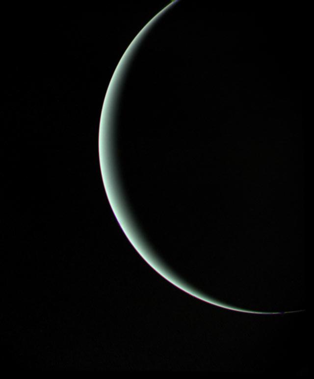 Crescent Uranus seen by Voyager 2.