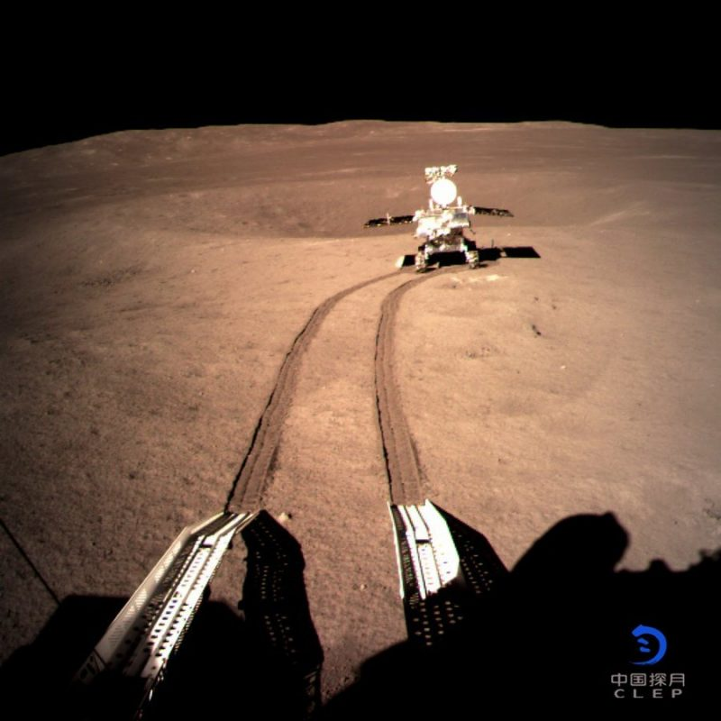 Tire tracks leading to small machine with solar panel 'wings' and antennas.