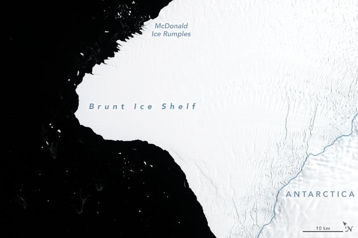 Large white area (ice) against black ocean.