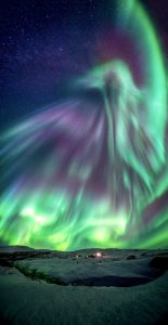 Aurora with the shape of a huge rising bird