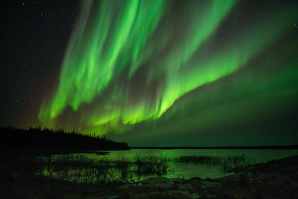 Florescent green waves on a dark sky.