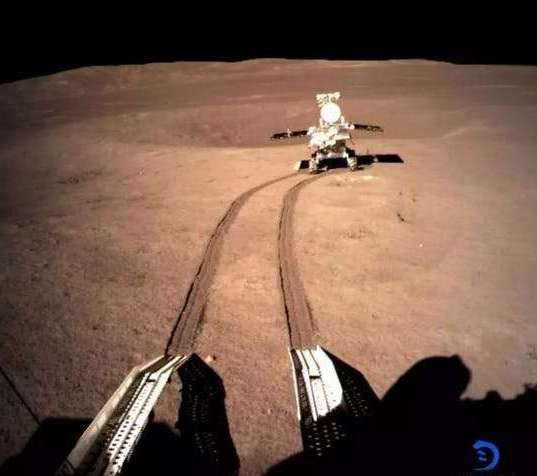Tire tracks leading to rover.