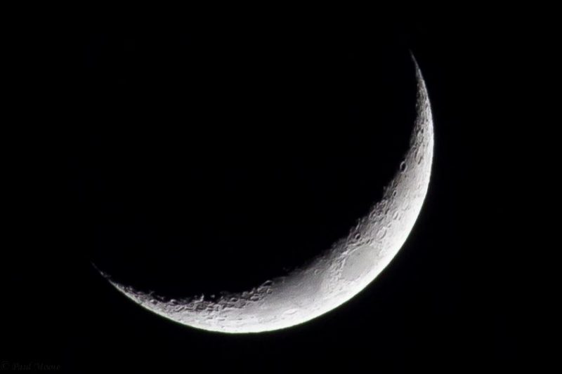 White crescent moon on a black background.