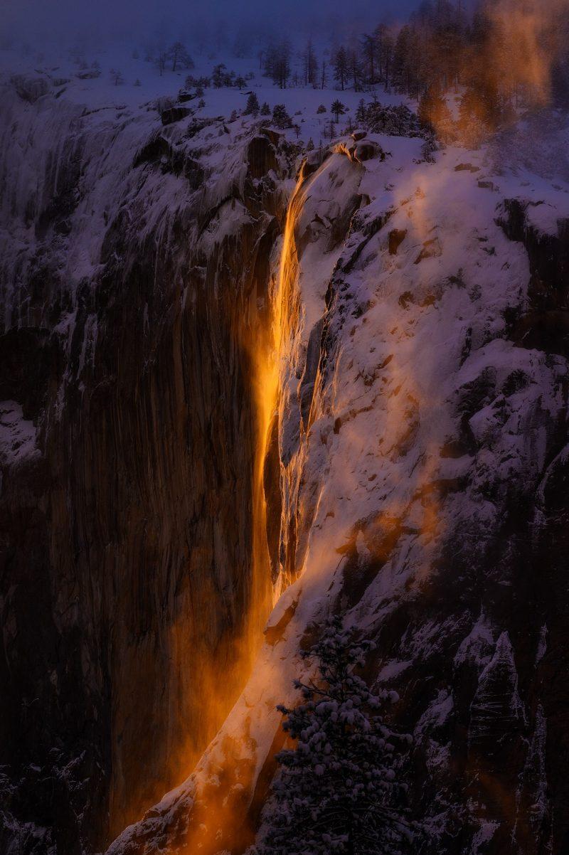 Waterfall lit by an orange glow