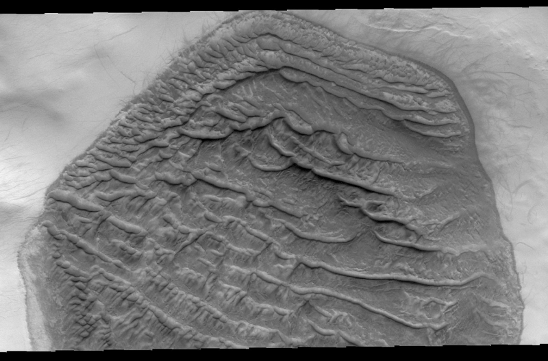 Hexagonal dune field on Mars with parallel stripes (dunes) running from upper left to lower right.