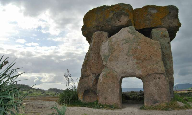 A house-like structure, built of massive stones.