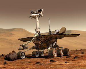 Rover spacecraft on reddish-brown landscape