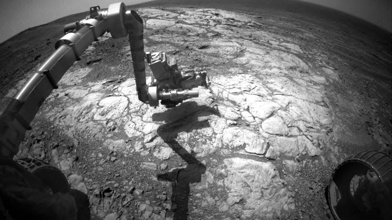 Jointed arm with tools, picture taken from main body of rover.