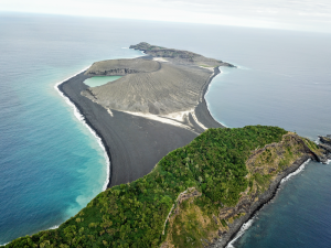 View of island from the above, gray mound in the center.