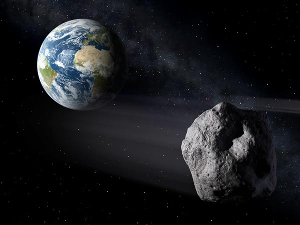 Irregular space rock in foreground, Earth in background.