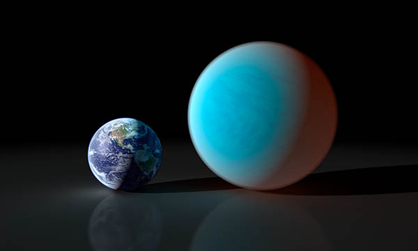 Smaller Earth next to blue planet over twice Earth's diameter.