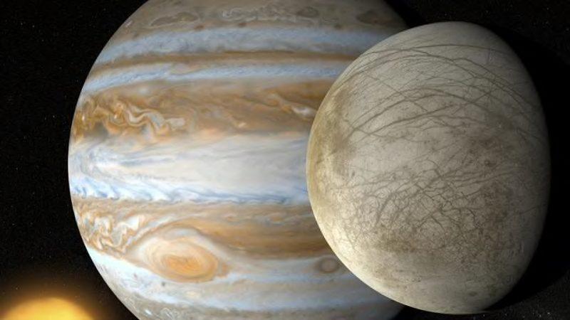 Jupiter in background, Europa in foreground.