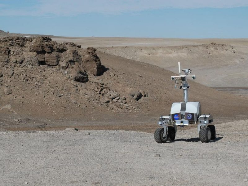 Four-wheeled rover with equipment sticking out of the top.