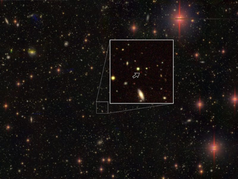 Starry sky with part enlarged to show dot that is a quasar.