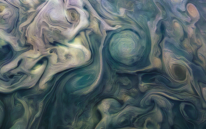 Detailed mostly blue swirls in planet Jupiter atmosphere.