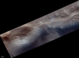 Layered terrains in crater.