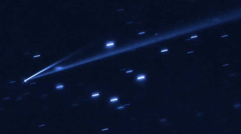 A starry point - the asteroid - with 2 long streaks extending from it.