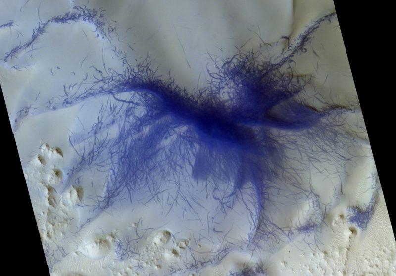 Spider-like burst of many dust devil tracks.