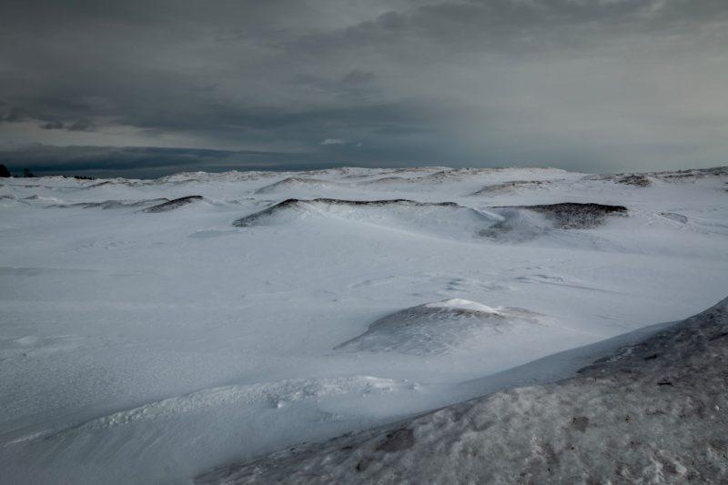Frozen surging water on lakeshore.