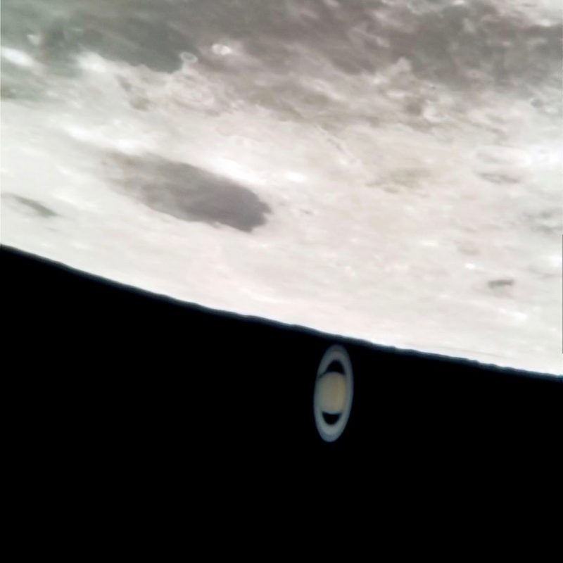 Telescopic view of moon and Saturn, with Saturn right next to the moon.