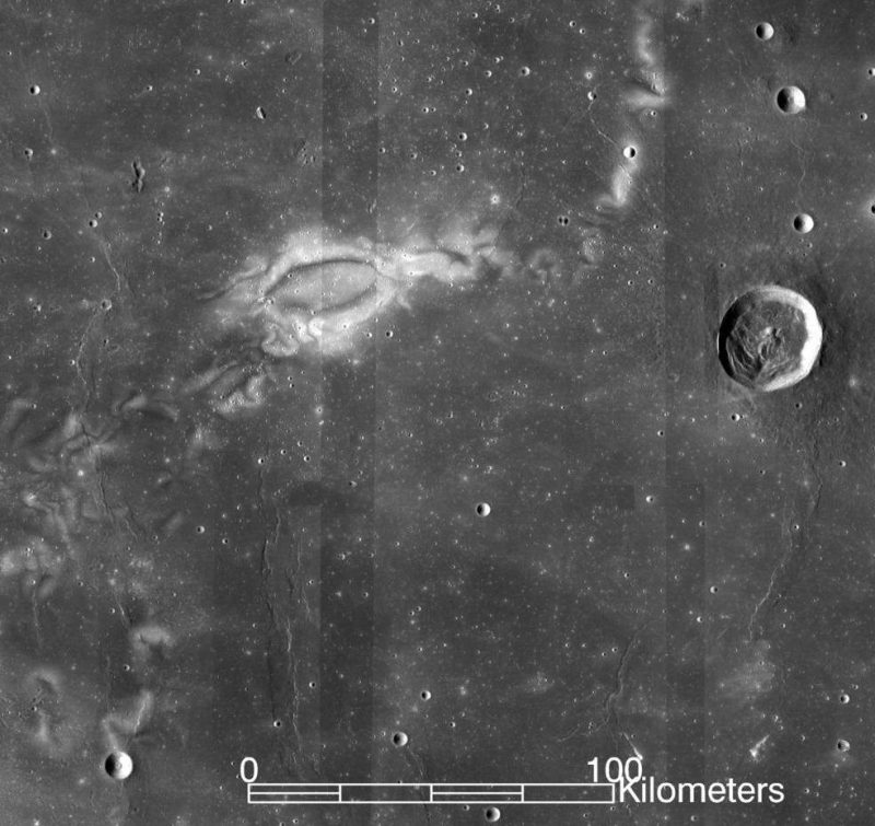 Light colored oval and wiggly lines on darker gray lunar surface.