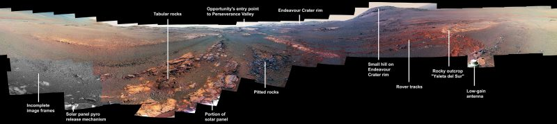 long image of Martian landscape, rocky and reddish-bluish, with features labeled.