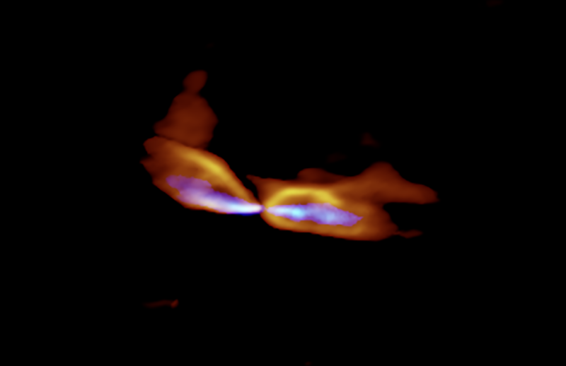 A wide orange outflow of gas on each side of a star, surrounding blue jets, from a central point.