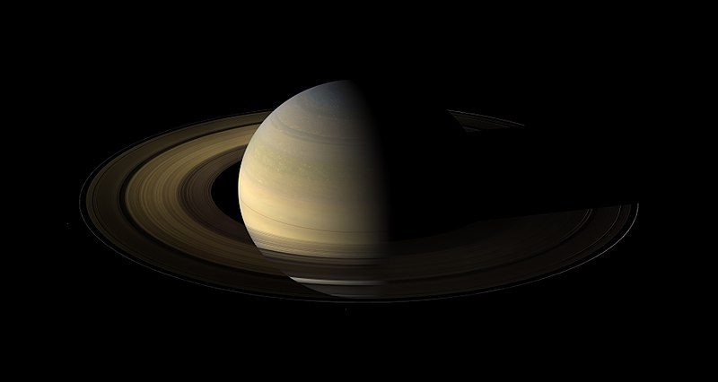 Oblique view of planet Saturn with rings.