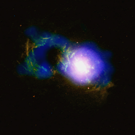 Ring of colored gases on left next to bright circle white in the middle surrounded by blue.
