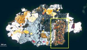 Thin slice of meteorite.
