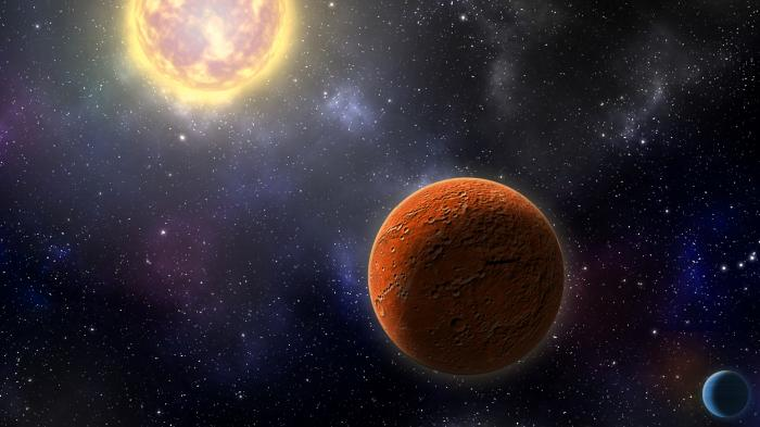 Roiling sun with orange crescent planet in foreground against star field.