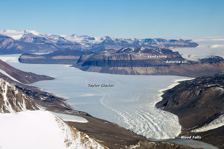 Large glacier flowing from between Arctic mountains with location of Blood Falls marked.