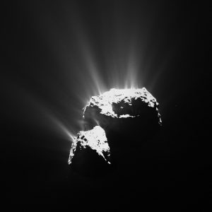 Comet 67P, with multiple dust jets spewing from it.