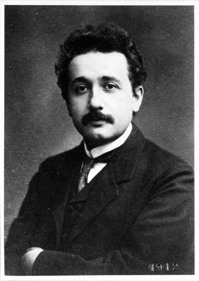 A dark-haired man with a mustache and a dignified expression, in a suit.
