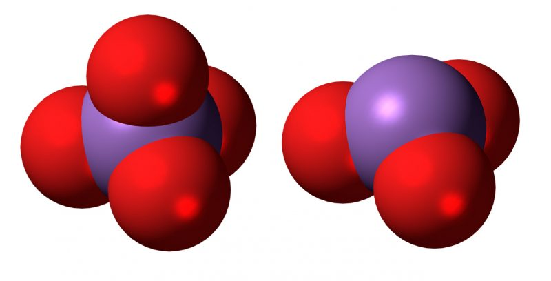 2 large purple balls with red balls stuck to them.