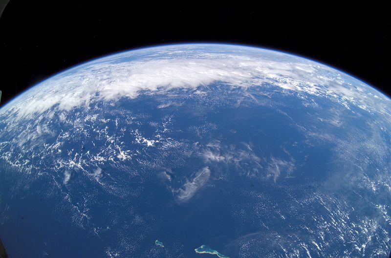 Earth's oceans from space with clouds.