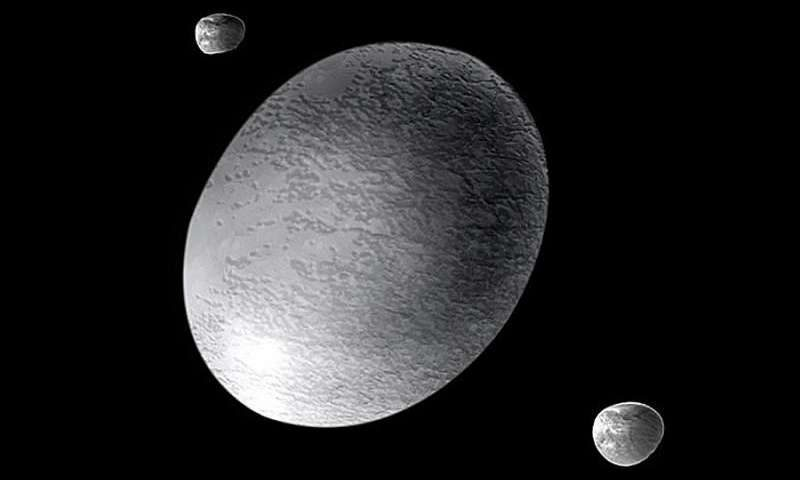 Oval space object with two much smaller roundish objects against black sky.