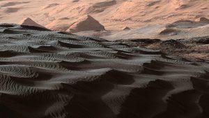 Dark rippled sand dunes on Mars.
