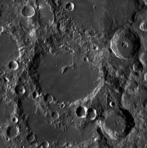View from above of a round lunar impact crater.