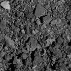 Grey sharp-edged rocks of various sizes.