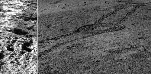 Stark lunar landscape, and rover tracks.