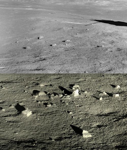 Stark lunar landscape with scattered isolated rocks.