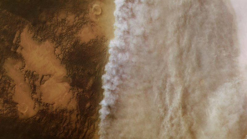 Billowing line of dust across Martian landscape.