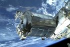 Spacecraft in front of blue planet Earth