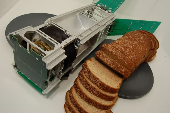 The Cubesat LightSail 2 next to a loaf of bread.